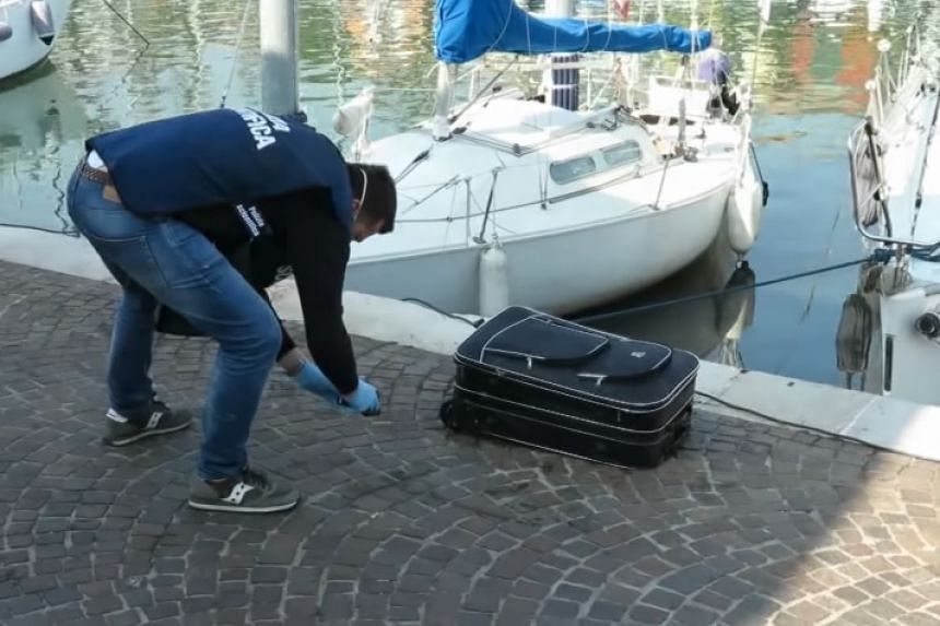 A screenshot of the suitcase in which the body was found from an online Italian news report.