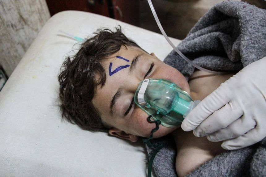 A Syrian child receives treatment after the alleged chemical attack at a field hospital in Saraqib, Idlib province, northern Syria, April 4, 2017.