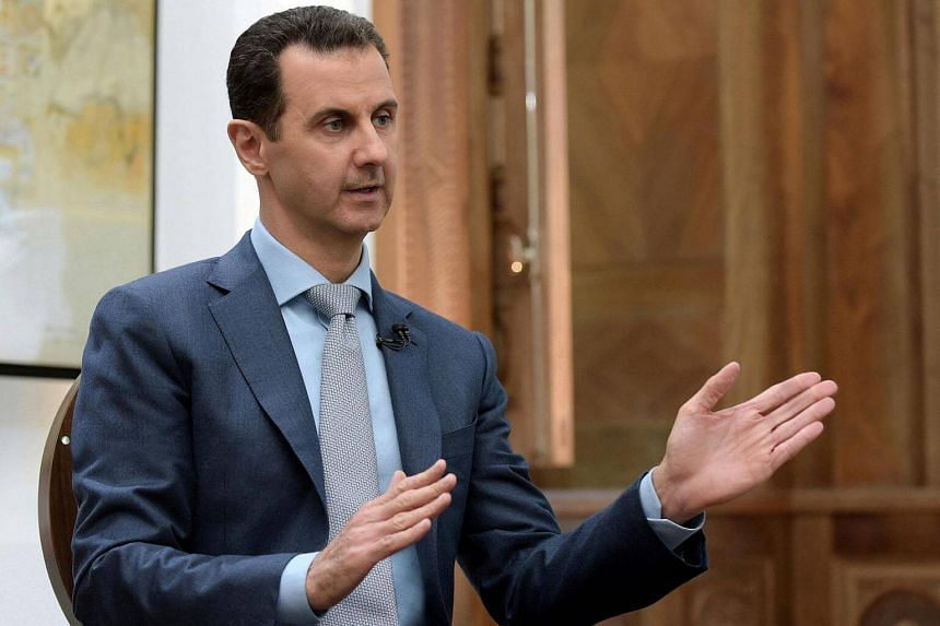 Syria's President Bashar al-Assad speaks during an interview with Yahoo News in this handout picture provided by SANA on Feb 10, 2017, in Syria.