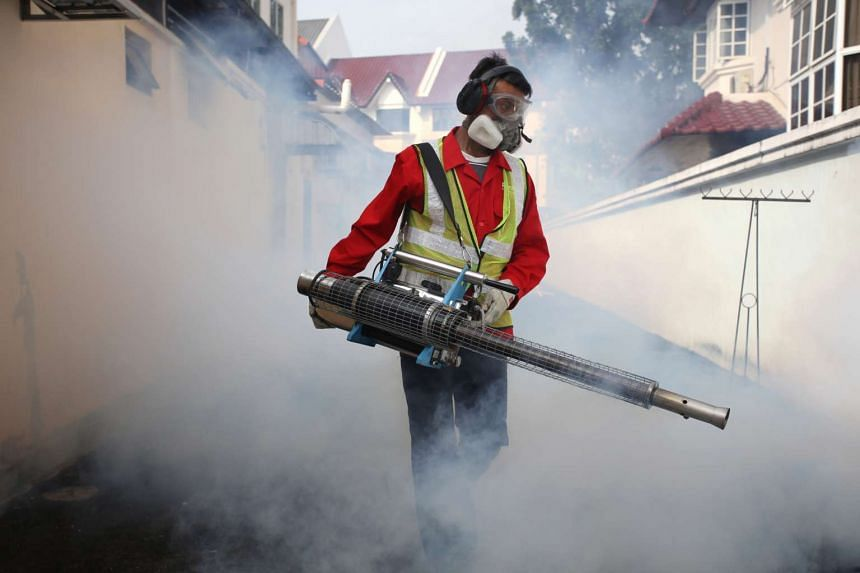 NEA officers and pest control operators fumigating the vicinity of Simon Place after a case of Zika was reported.