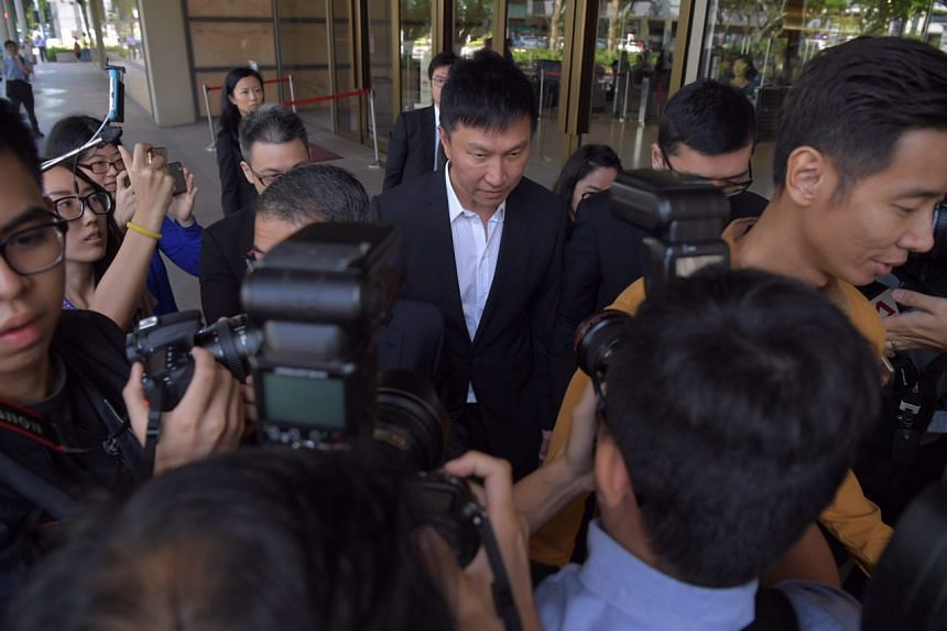 Church founder Kong Hee (centre) leaving the High Court on Friday (April 7).