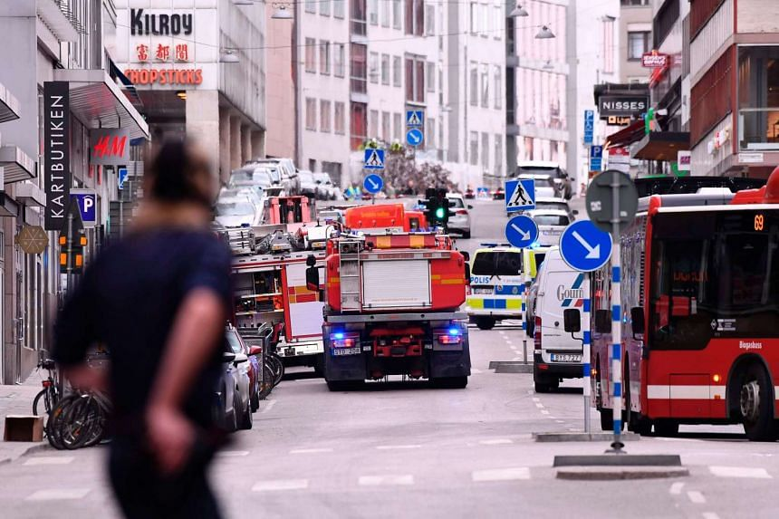 Emergency services work at the scene where a truck crashed into the Ahlens department store at Drottninggatan in central Stockholm on April 7, 2017.