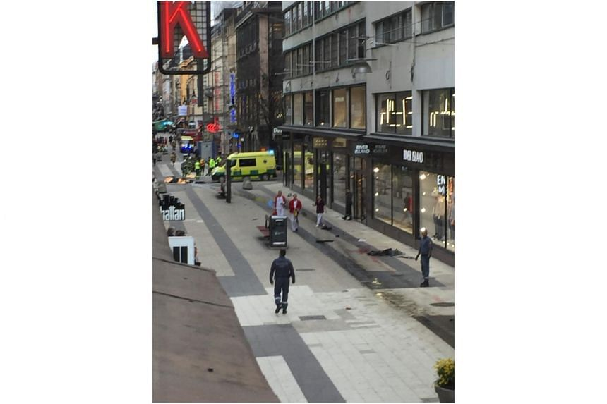 The scene where a truck crashed into the Ahlens department store at Drottninggatan in central Stockholm.