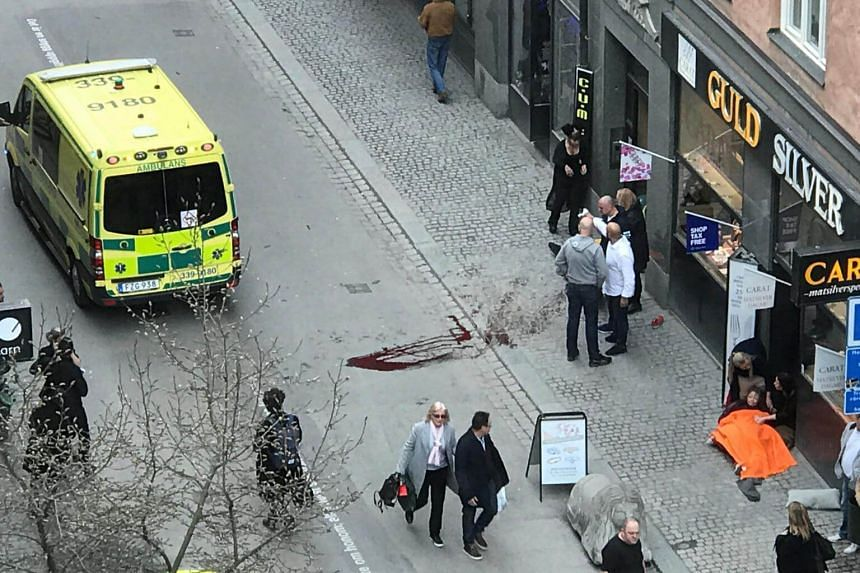 Ambulance in a street near the site were a truck was driving into a crowd in central Stockholm.