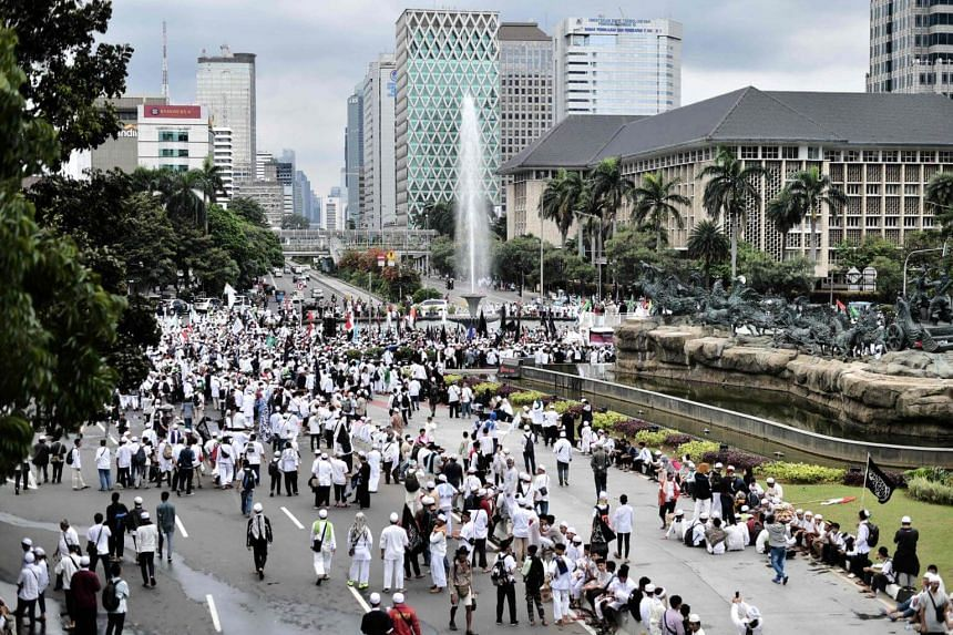 "Indonesian Muslims protest in Jakarta to demand that Governor Basuki ""Ahok"" Tjahaja Purnama be jailed for allegedly blaspheming Islam."