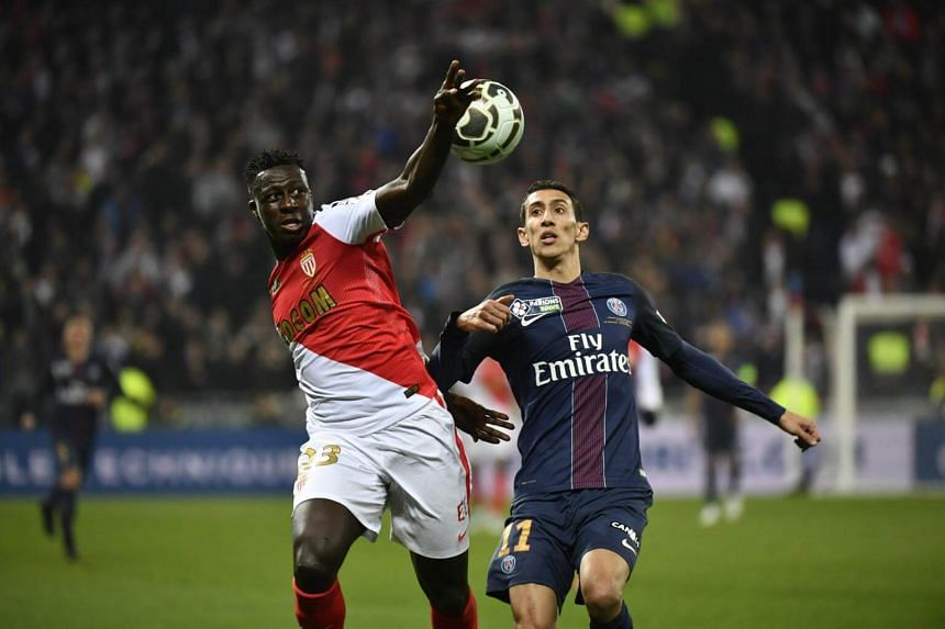 PSG forward Angel Di Maria (right) vies for the ball with Monaco's Benjamin Mendy during the League Cup final.