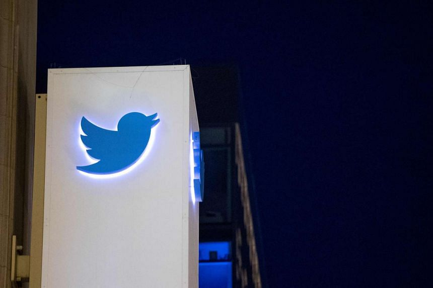 A 2016 photo shows the Twitter logo on a sign at the company's headquarters in San Francisco, California.