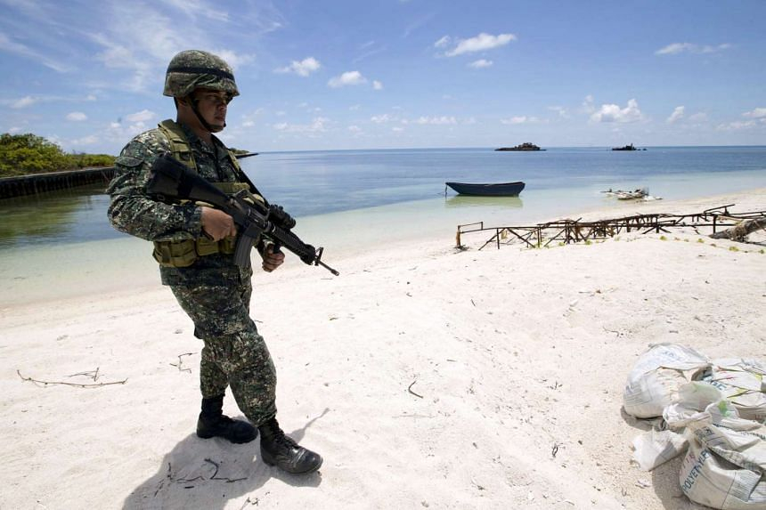 A Filipino soldier patrols at the shore of Pagasa island (Thitu Island) in the Spratly group of islands in the South China Sea, west of Palawan, Philippines on May 11, 2015.
