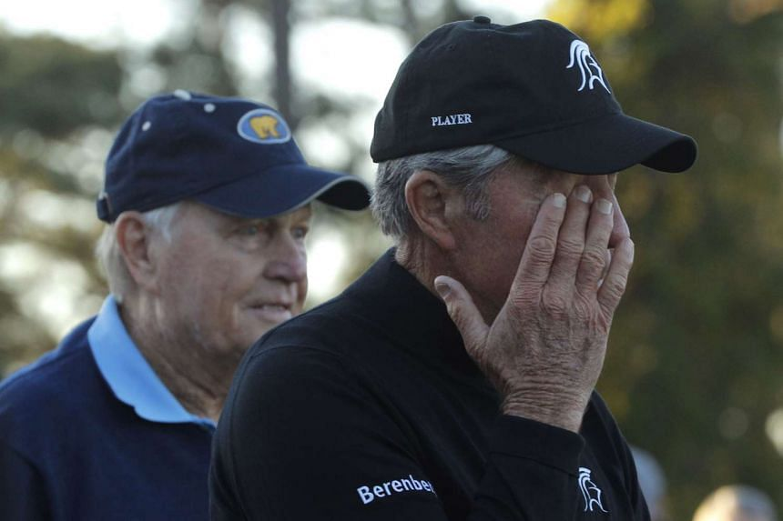 Gary Player wipes a tear away as he stands with Jack Nicklaus during the ceremonial tee off to start the 2017 Masters.
