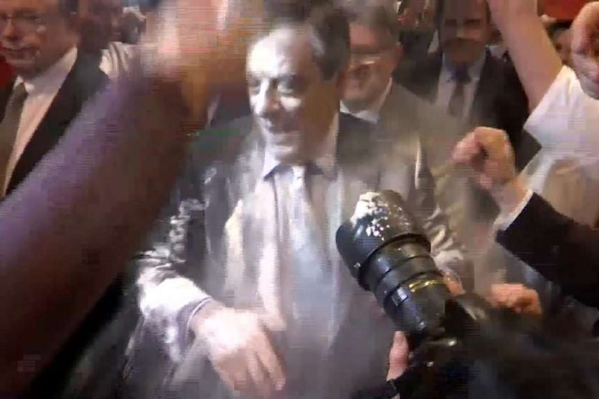 A video screengrab shows Fillon after the attack.