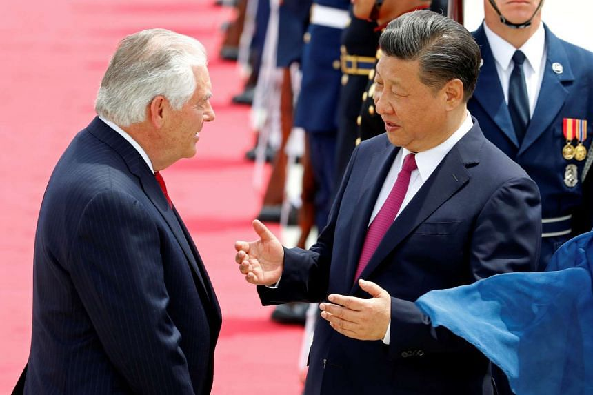 US Secretary of State Rex Tillerson (left) greets China's President Xi Jinping upon his arrival.