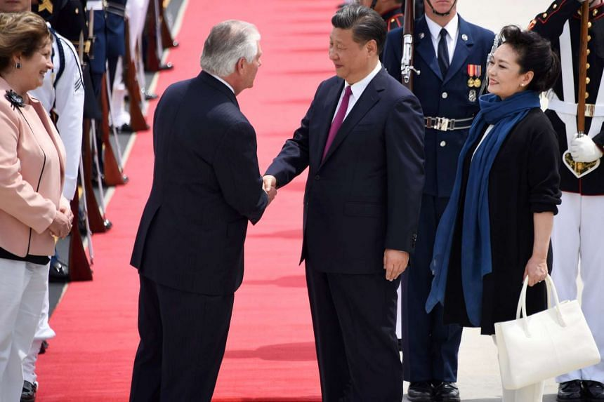 US Secretary of State Rex Tillerson (left) and his wife Renda St Clair greet China's President Xi Jinping (second right) and his wife Peng Liyuan.