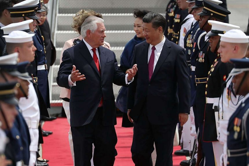 US Secretary of State Rex Tillerson talks with Chinese President Xi Jinping as he arrives in the US.