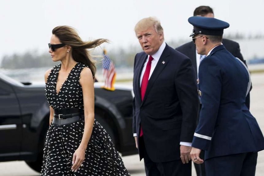 President Donald Trump and First Lady Melania Trump exit Air Force One at Palm Beach International Airport.
