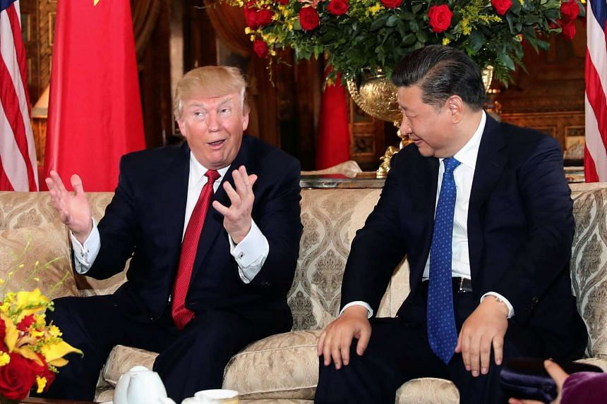 US President Donald Trump interacting with Chinese President Xi Jinping at Mar-a-Lago state in Palm Beach, Florida, US, on April 6, 2017.