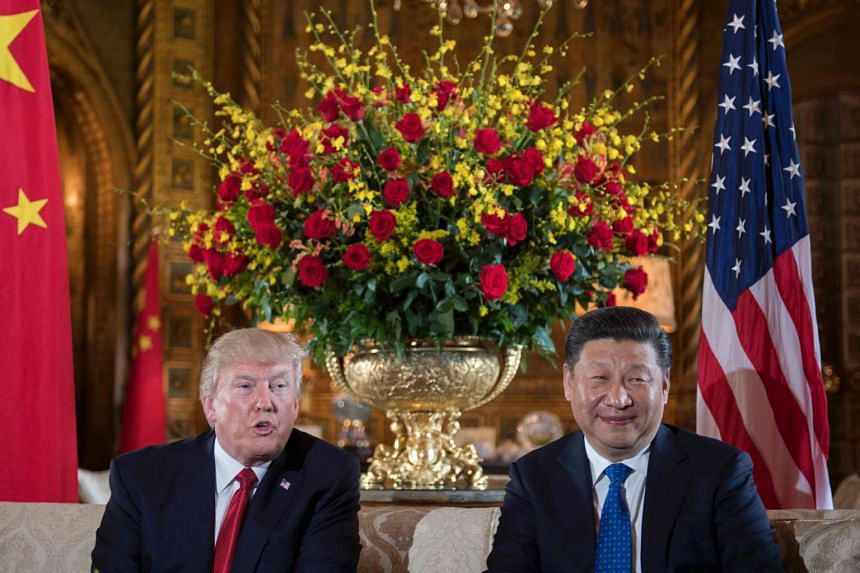 US President Donald Trump (left) sitting with Chinese President Xi Jinping during a bilateral meeting at the Mar-a-Lago estate in West Palm Beach, Florida, on April 6, 2017.