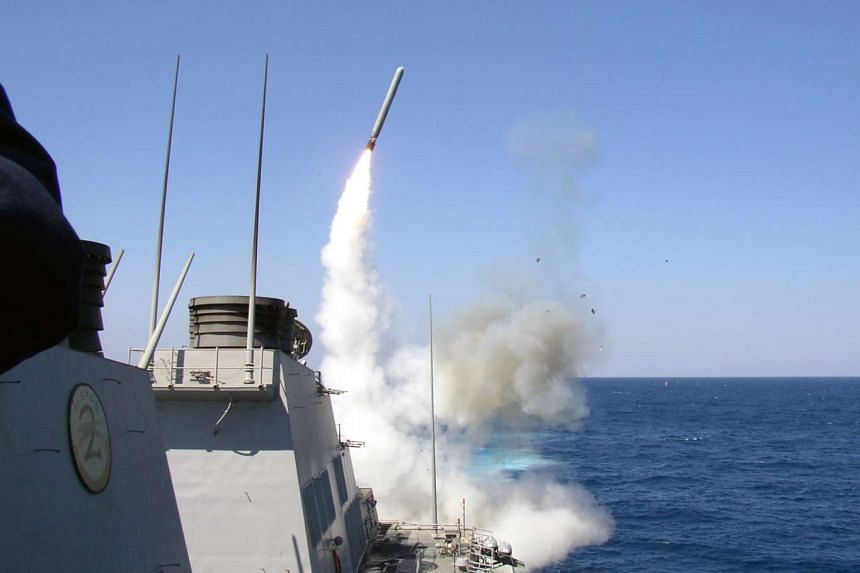 A file photo obtained from the US Navy showing the guided missile destroyer USS Porter launching a Tomahawk missile, on March 22, 2003.