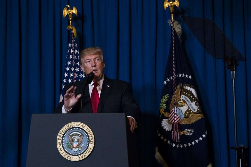 US President Donald Trump making a statement about the American attack on an air base in Syria, at his Mar-a-Lago resort in Palm Beach, Florida, on April 6, 2017.