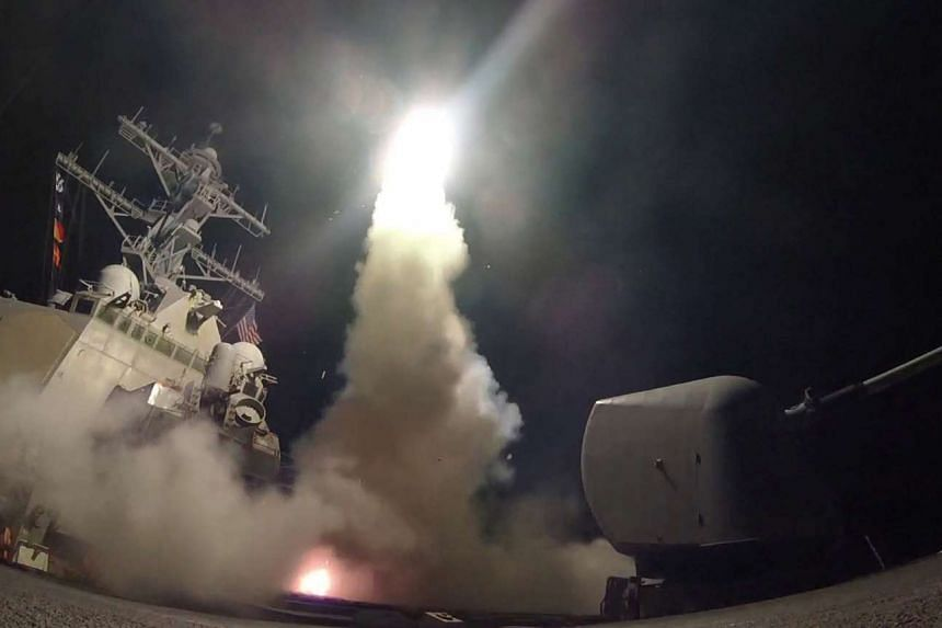US Navy guided-missile destroyer USS Porter (DDG 78) conducting strike operations while in the Mediterranean Sea. The US Defense Department said this was part of a cruise missile strike against Syria on April 7, 2017.