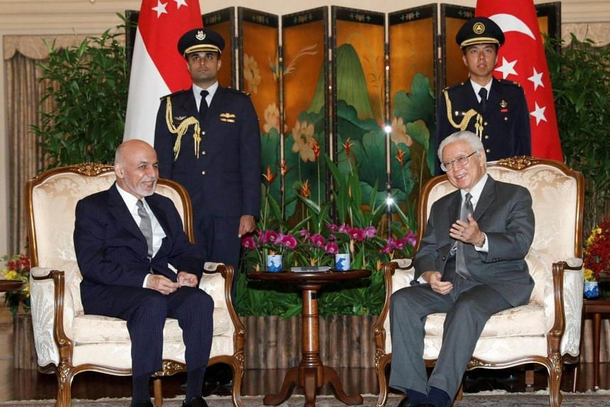 Afghan President Mohammad Ashraf Ghani with President Tony Tan Keng Yam at the Istana.