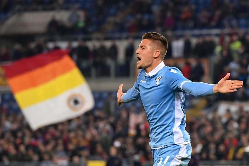 Lazio's Sergej Milinkovic-Savic celebrates after scoring the 0-1 goal during the Coppa Italia semi final second leg soccer match between AS roma and SS Lazio at the Olimpico stadium in Italy, on April 4, 2017.