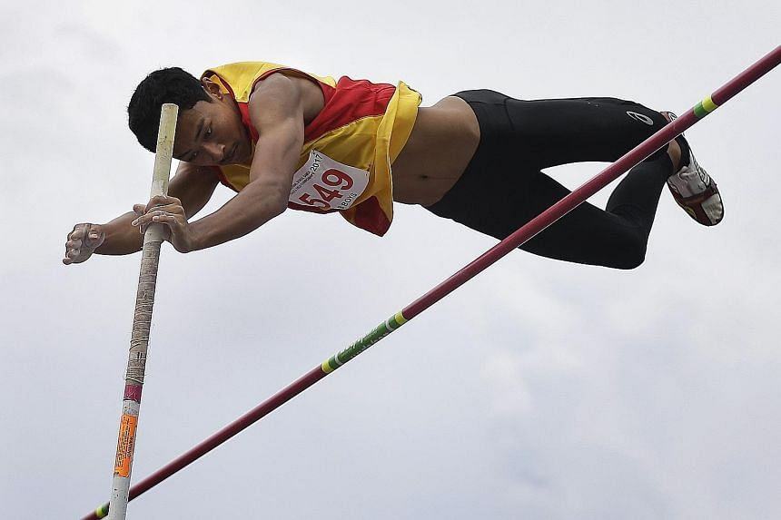 Sachin Esan in action during the B Division boys' pole vault finals at Bishan Stadium. He led a 1-2-3 sweep for Hwa Chong Institution yesterday, winning gold after clearing 4m.