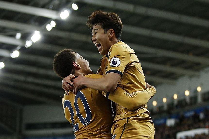 Left: Tottenham's Son Heung Min celebrating with Dele Alli after putting his side ahead in added time against Swansea City.