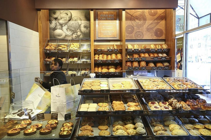 """A Panera Bread restaurant in New York. Panera has been attracting diners with a move towards """"cleaner"""" ingredients, including bacon made without artificial nitrates and preservatives. With JAB's backing, Panera could expand internationally and compet"""