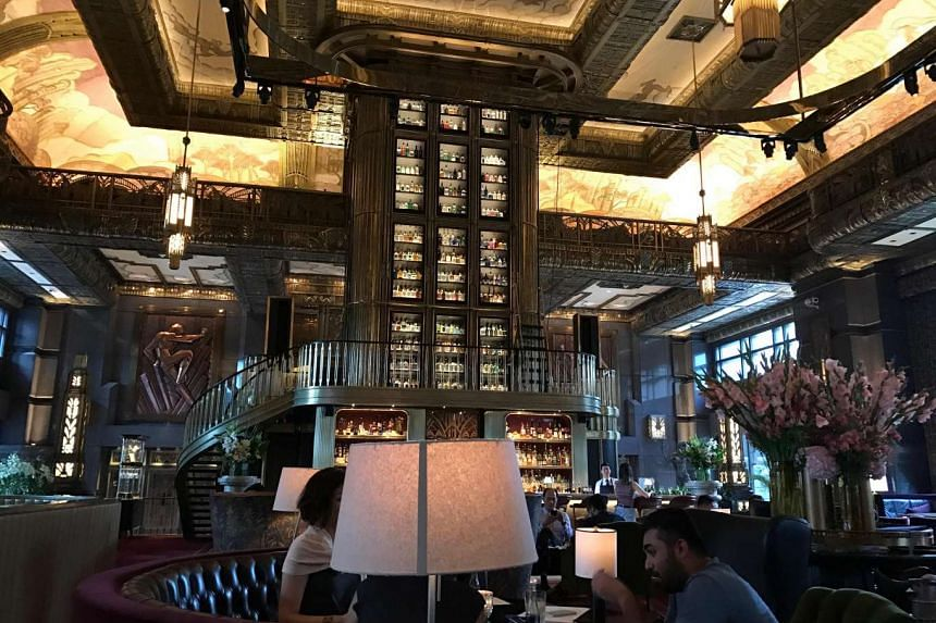 Atlas, with its super-high ceilings and eclectic art, bridges the gap between having a drink and deciding where to have dinner next. PHOTO: ATLAS
