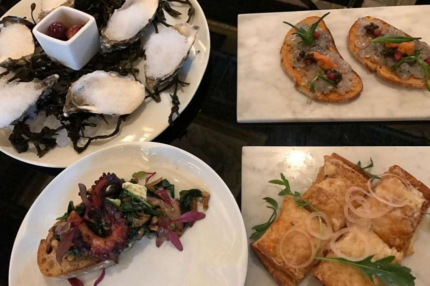 Clockwise from top left: Irish oysters with champagne vinegar air and fizzy grapes, bruschetta triumph of the sea with blue prawn tartar, sea urchin, pomegranate and oscietra caviar, mini croque monsieur with fancy Spanish cheese and rocket, and char