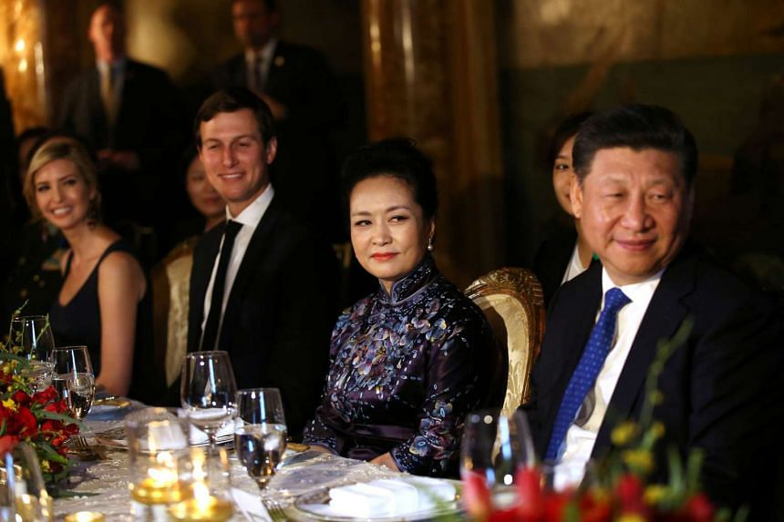 China's first lady Peng Liyuan (second, right) looking at Chinese President Xi Jinping (right) as she sits next to Trump Senior Advisor Jared Kushner and Ivanka Trump (left), during a dinner at the start of a summit between US President Donald Trump