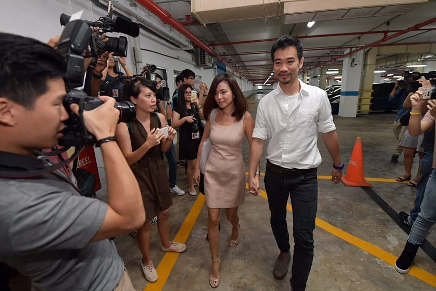 Former City Harvest Church finance manager Serina Wee and her husband Kenny Low arriving in court.