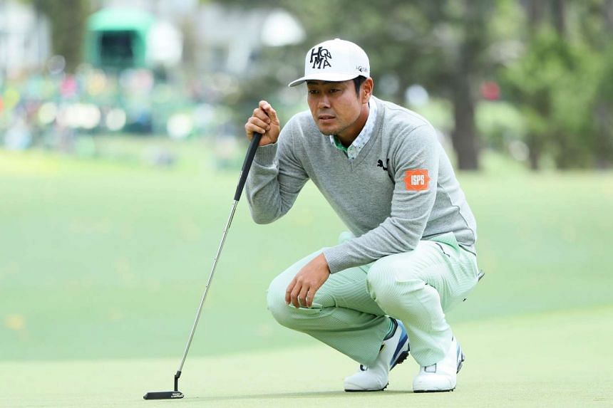 Hideto Tanihara lining up a putt during the first round of the 2017 Masters Tournament at Augusta National Golf Club on April 6, 2017.