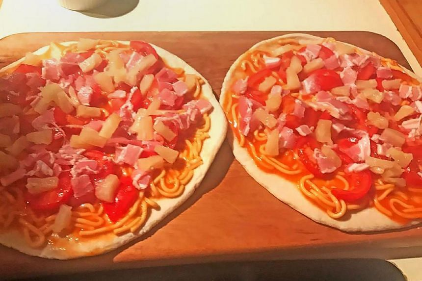 This undated photo released by New Zealand Prime Minister Bill English from his Facebook page on April 7, 2017, shows pizzas Mr English made topped with tinned spaghetti and pineapple for his family in Wellington.