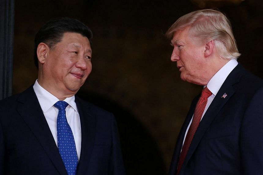 US President Donald Trump (right) welcomes Chinese President Xi Jinping to the Mar-a-Lago estate in West Palm Beach, Florida.