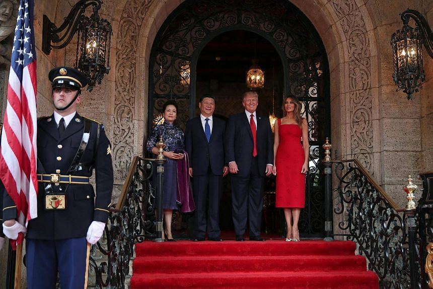 US President Donald Trump (second from right) and First Lady Melania Trump (right) welcoming Chinese President Xi Jinping (second from left) and first lady Peng Liyuan at Mar-a-Lago estate in Palm Beach, Florida, US, on April 6, 2017.