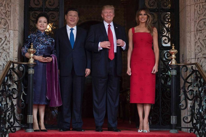 US First Lady Melania Trump (right) and President Donald Trump (second right) pose with Chinese President Xi Jinping (second left) and his wife Peng Liyuan upon their arrival to the Mar-a-Lago estate in West Palm Beach, Florida.