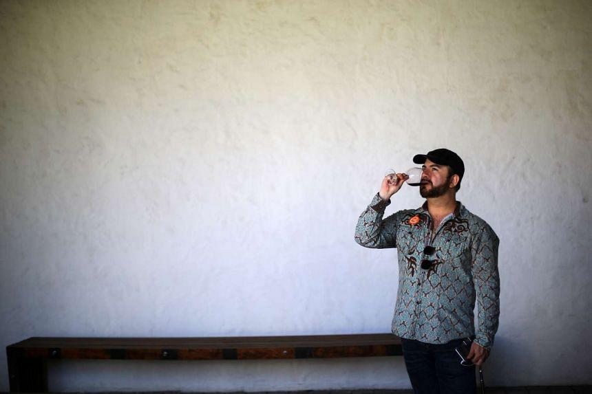 A man tastes wine at a vineyard near Santiago, Chile.