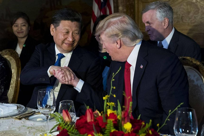 US President Donald Trump and Chinese President Xi Jinping shake hands during a dinner at Trump's Mar-a-Lago resort in Palm Beach, Florida.