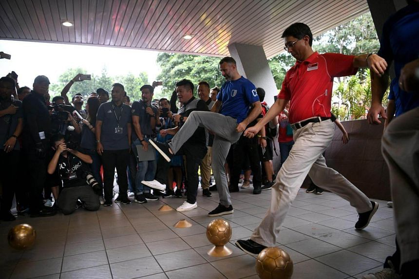 Parliamentary Secretary, Ministry of Education & Ministry of Social and Family Development Assoc Prof Dr Muhammad Faishal Ibrahim and Manchester United legend Ryan Giggs kick soccer balls towards a make-shift goal to officially open The Arena and Caf
