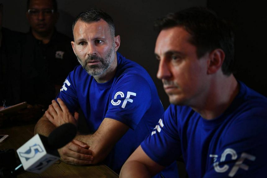 Manchester United legends Ryan Giggs (left) and Gary Neville speak to the media before the opening ceremony of The Arena and Cafe Football at Woodleigh Park on April 8, 2017.