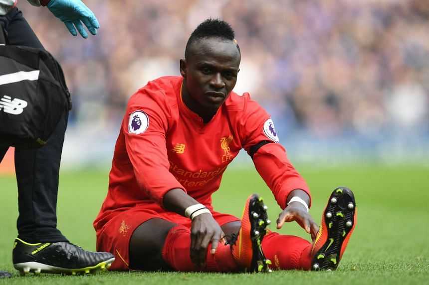 Liverpool's Senegalese midfielder Sadio Mane reacts after picking up an injury, April 1, 2017.