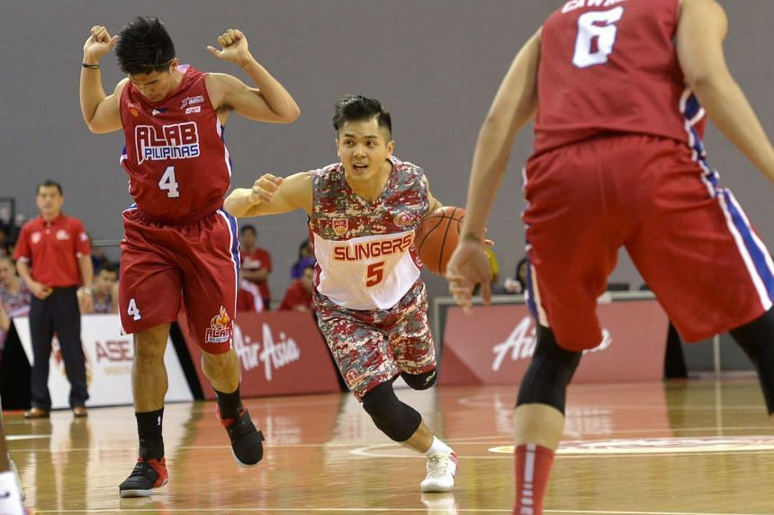 The Singapore Slingers (centre) in action as they pulled off a dominating 77-67 win over Alab Pilipinas in Game 1 of the best-of-three series for the Asean Basketball League semi-final playoffs at the OCBC Arena on April 2, 2017.
