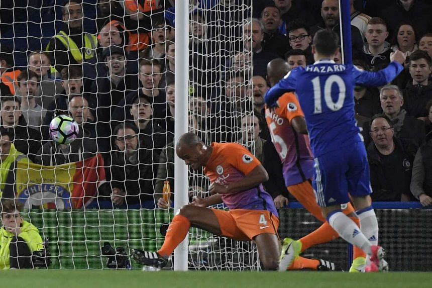 Chelsea's Eden Hazard scoring their first goal after a deflection by Manchester City's Vincent Kompany.