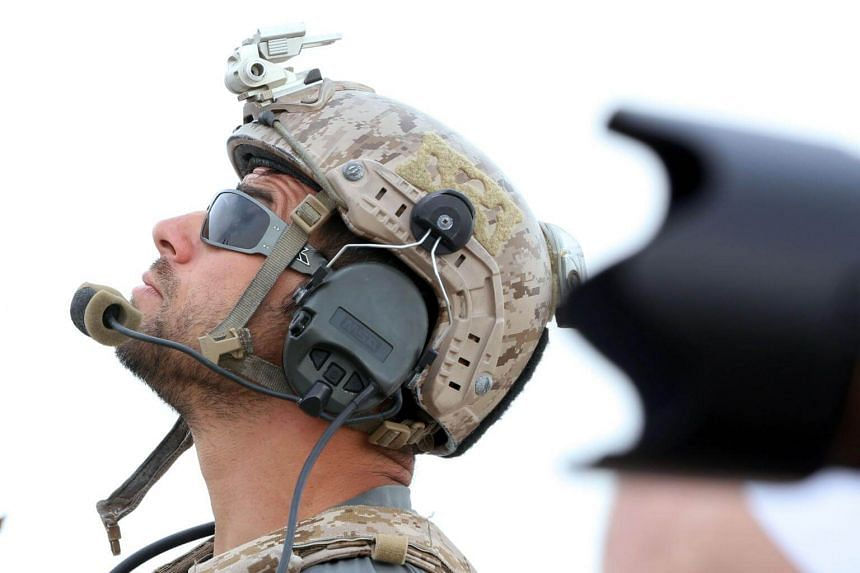 A US soldier looks on during a military exercise. About 1,000 US military personnel supported a month-long exercise which included a series of tactical demonstrations of land, maritime and air forces from several nations.