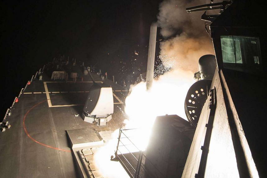A Tomahawk cruise missile is launched from the USS Ross in a strike on a Syrian air base on April 7, 2017. President Donald Trump called the strike a response to the Syrian government's chemical weapons attack this week that killed more than 80 civil