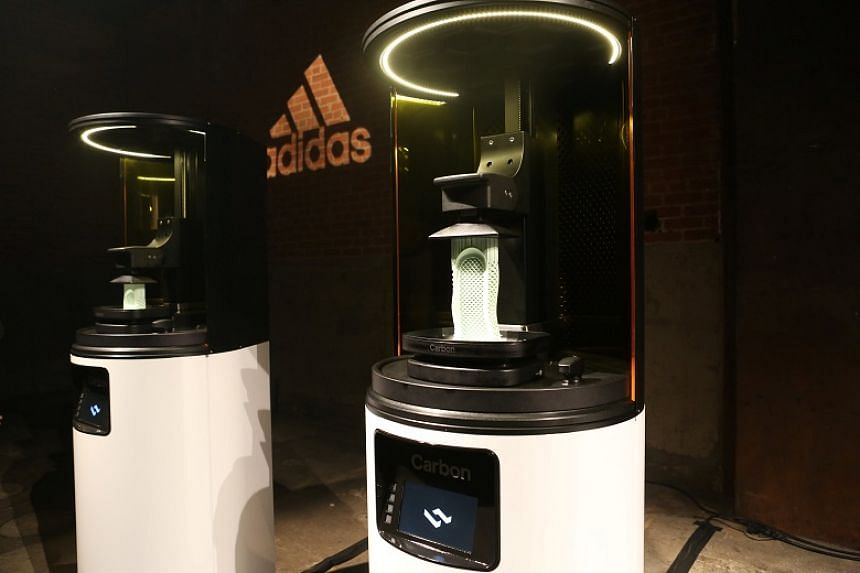 Carbon 3D printing machines at an unveiling event for the new Adidas Futurecraft shoe in New York, US, on April 6, 2017.