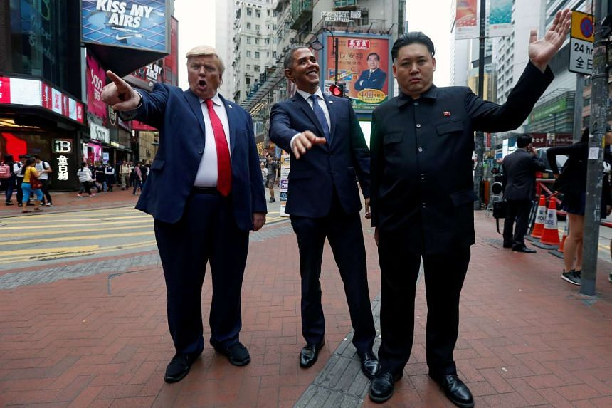 Howard X (right), an Australian-Chinese, impersonating North Korean leader Kim Jong-un, Reggie Brown (centre) impersonating former US President Barack Obama, and Dennis Alan, a musician from Chicago, impersonating US President Donald Trump, pose in H
