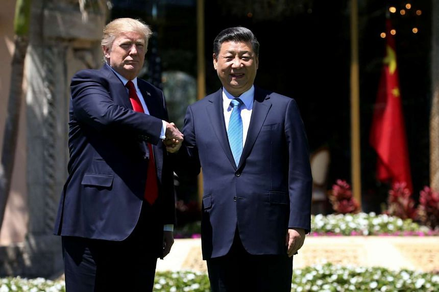 US President Donald Trump and China's President Xi Jinping shaking hands while walking at Mar-a-Lago estate after a bilateral meeting in Palm Beach, Florida, US, on April 7, 2017.