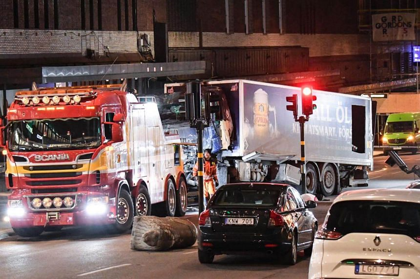 This picture taken on April 8, 2017, shows the truck that crashed into the Ahlens department store at Drottninggatan in central Stockholm the day before.